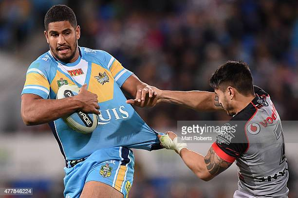 Nene MacDonald of the Titans is tackled by Shaun Johnson of the Warriors during the round 15 NRL match between the Gold Coast Titans and the New...