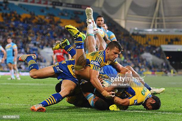 Nene MacDonald of the Titans scores a try during the round 21 NRL match between the Gold Coast Titans and the Parramatta Eels at Cbus Super Stadium...