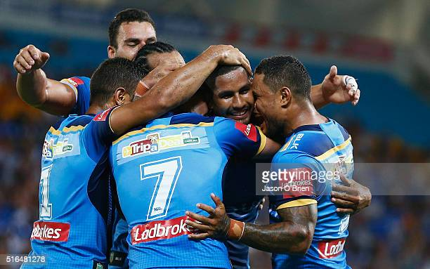 Nene Macdonald of the Titans scores a try during the round three NRL match between the Gold Coast Titans and the Wests Tigers at Cbus Super Stadium...