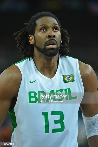 Nene of Brazil shoots against Argentina during their Basketball Game on Day 10 of the London 2012 Olympic Games at the North Greenwich Arena on...