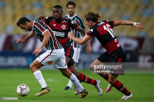 Nene of Fluminense fights for the ball against Gerson and Filipe Luis of Flamengo during the match between Flamengo and Fluminense as part of the...