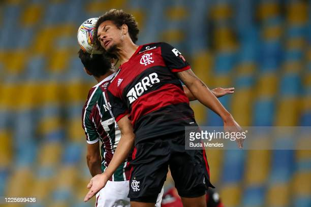 Nene of Fluminense heads the ball against Willian Arao of Flamengo during the match between Flamengo and Fluminense as part of the Taca Rio the...