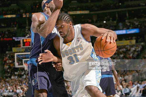 Nene of the Denver Nuggets drives to the basket against Erick Dampier of the Dallas Mavericks at the Pepsi Center on April 6 2007 in Denver Colorado...
