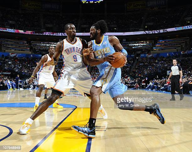 Nene of the Denver Nuggets drives to the basket against Serge Ibaka of the Oklahoma City Thunder at the Oklahoma City Arena on December 25 2010 in...