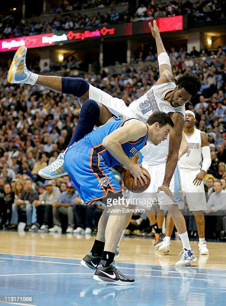 Nene of the Denver Nuggets falls over the back and fouls Nick Collison of the Oklahoma City Thunder in Game Four of the Western Conference...