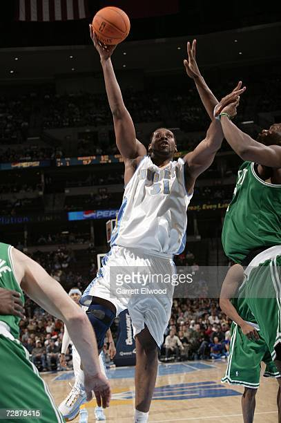 Nene of the Denver Nuggets goes to the basket against the Boston Celtics at the Pepsi Center December 26 2006 in Denver Colorado The Nuggets won the...