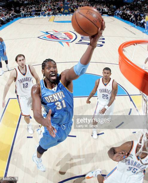 Nene of the Denver Nuggets goes to the basket against the Oklahoma City Thunder at the Ford Center on February 4 2009 in Oklahoma City Oklahoma NOTE...