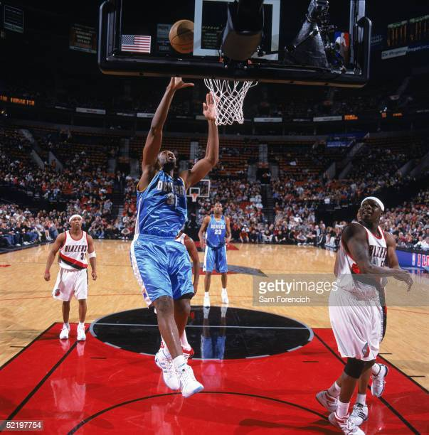 Nene of the Denver Nuggets goes to the basket during a game against the Portland Trail Blazers at The Rose Garden on February 2 2005 in Portland...