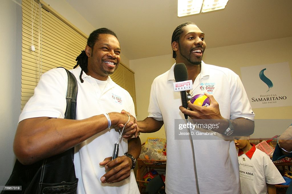Nene (L) of the Denver Nuggets interviews Sam Perkins former NBA player for ESPN Brazil during Basketball Without Borders on August 3, 2007 in Sao Paulo, Brazil.
