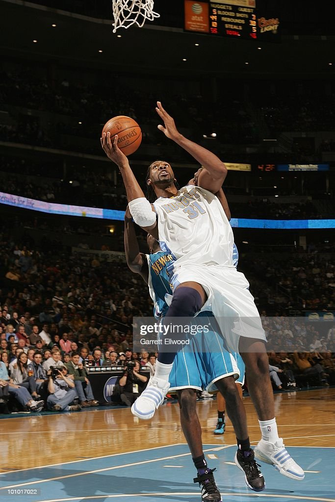 Nene #31 of the Denver Nuggets looks to score against a New Orleans Hornets defender during the game on March 18, 2010 at the Pepsi Center in Denver, Colorado. The Nuggets won 93-80.