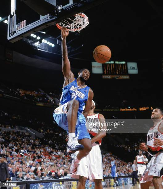 Nene of the Denver Nuggets makes a dunk against the Portland Trail Blazers at the Rose Garden on October 20 2003 in Portland Oregon The Nuggets won...