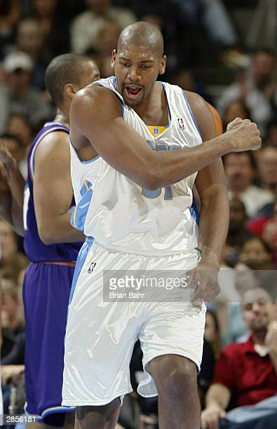 Nene of the Denver Nuggets pumps his fist after getting a basket and the foul against the Utah Jazz in the first half January 9 2004 at the Pepsi...