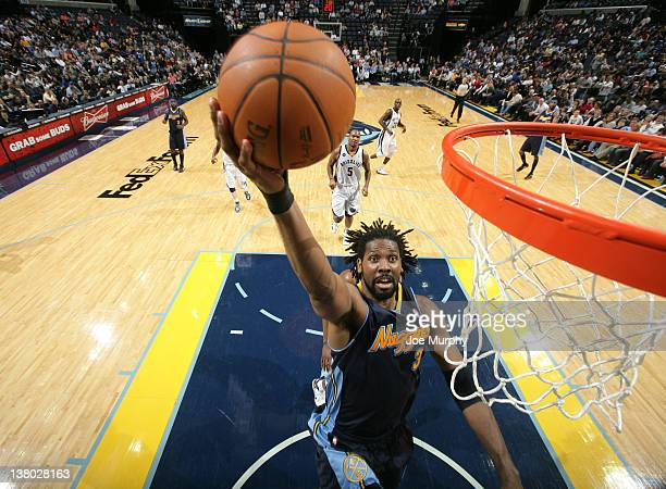 Nene of the Denver Nuggets shoots a layup against the Memphis Grizzlies on January 31 2012 at FedExForum in Memphis Tennessee NOTE TO USER User...