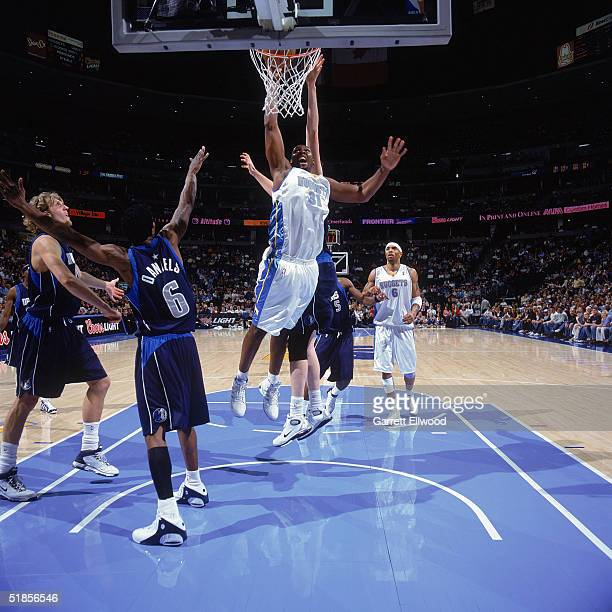 Nene of the Denver Nuggets shoots during the game with the Dallas Mavericks at Pepsi Center on November 19 2004 in Denver Colorado The Nuggets won...