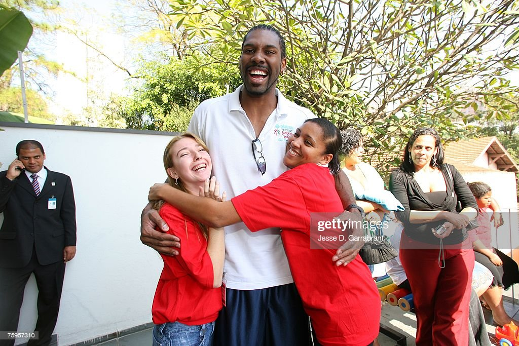 Nene of the Denver Nuggets takes a picture with some fans during Basketball Without Borders on August 3, 2007 in Sao Paulo, Brazil.