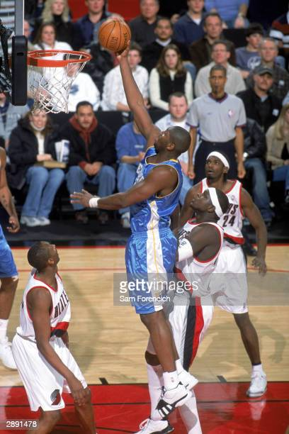 Nene of the Denver Nuggets takes the ball to the basket during the NBA game against the Portland Trail Blazers at The Rose Garden on January 2 2004...