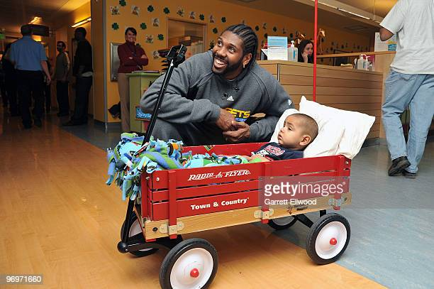 Nene of the Denver Nuggets visits a patient on February 22 2010 at Children's Hospital in Aurora Colorado NOTE TO USER User expressly acknowledges...