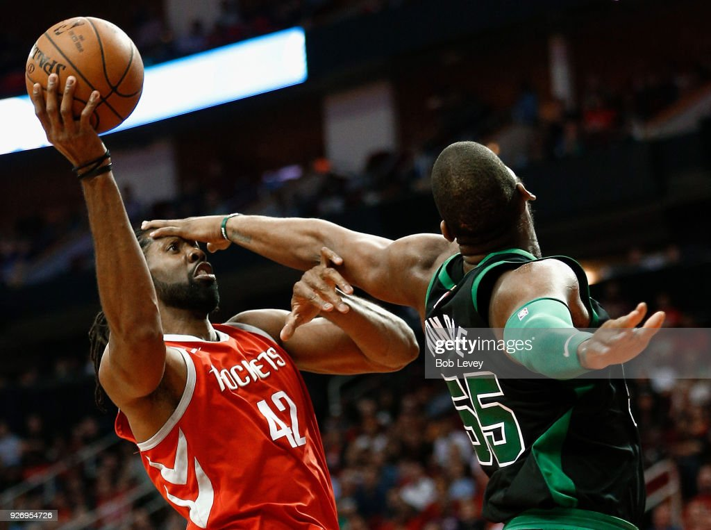 Nene #42 of the Houston Rockets drives to the basket as Greg Monroe #55 of the Boston Celtics defends at Toyota Center on March 3, 2018 in Houston, Texas.