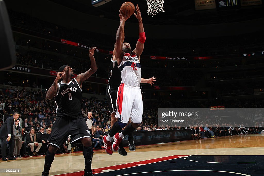 Nene #42 of the Washington Wizards drives to the basket against the Brooklyn Nets on January 4, 2013 at the Verizon Center in Washington, DC.
