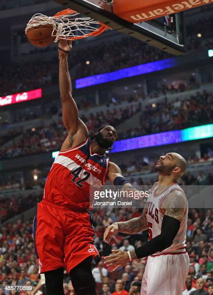 Nene of the Washington Wizards dunks over Carlos Boozer of ...