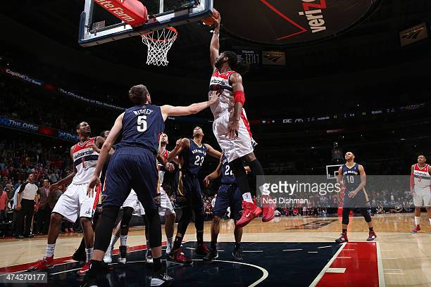 Nene of the Washington Wizards dunks the gamewinning basket against Jeff Withey of the New Orleans Pelicans during the game at the Verizon Center on...
