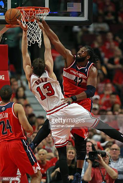 Nene of the Washington Wizards fouls Joakim Noah of the Chicago Bulls in Game One of the Eastern Conference Quarterfinals during the 2014 NBA...
