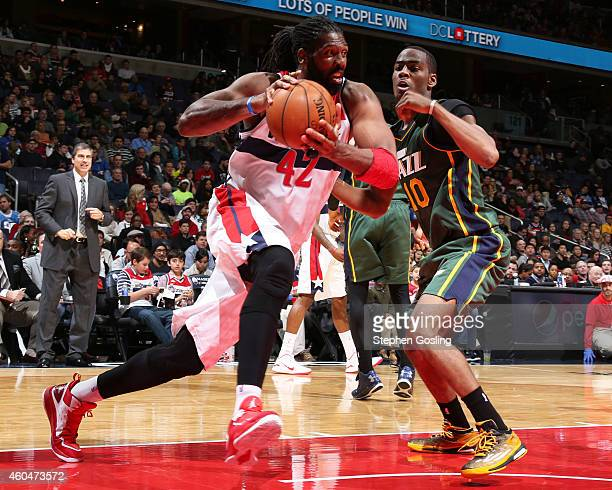 Nene of the Washington Wizards handles the ball against the Utah Jazz at the Verizon Center on December 14 2014 in Washington DC NOTE TO USER User...