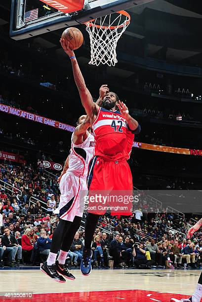 Nene of the Washington Wizards puts up a shot against the Atlanta Hawks on January 11 2015 at Philips Arena in Atlanta Georgia NOTE TO USER User...
