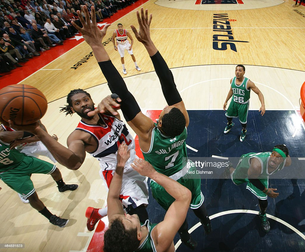Nene #42 of the Washington Wizards shoots against Jared Sullinger #7 of the Boston Celtics during the game at the Verizon Center on January 22, 2014 in Washington, DC.