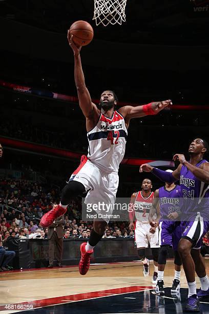 Nene of the Washington Wizards shoots against the Sacramento Kings during the game at the Verizon Center on February 9 2014 in Washington DC NOTE TO...