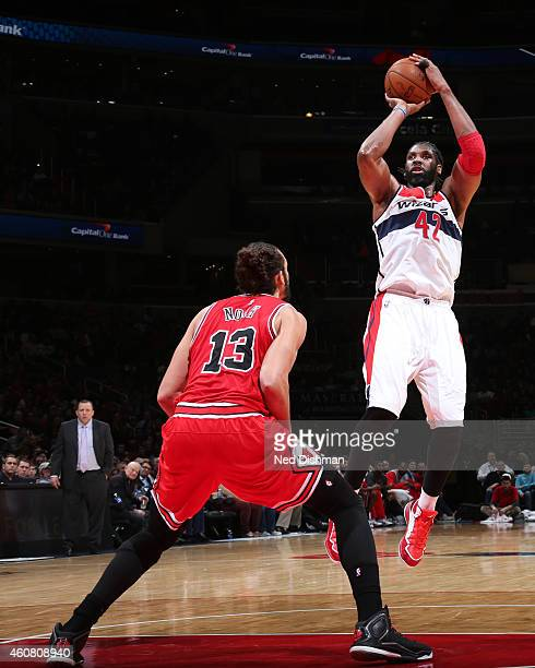 Nene of the Washington Wizards takes a shot against the Chicago Bulls on December 12 2014 in Washington DC NOTE TO USER User expressly acknowledges...
