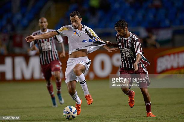 Nene of Vasco battles for the ball with Gustavo Scarpa of Fluminense during the match between Vasco and Fluminense as part of Brasileirao Series A...