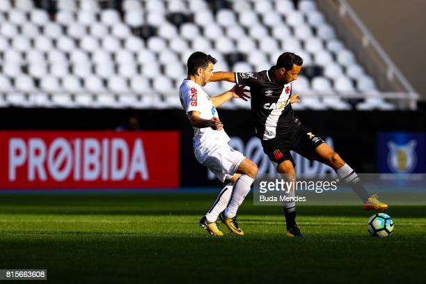 Nene of Vasco da Gama struggles for the ball with Leandro Donizete of Santos during a match between Vasco da Gama and Santos as part of Brasileirao...