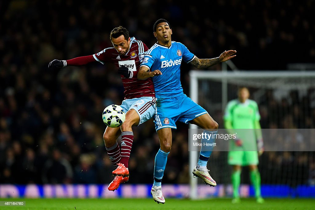 Nene of West Ham jumps for the ball with Patrick van Aanholt of Sunderland during the Barclays Premier League match between West Ham United and Sunderland at Boleyn Ground on March 21, 2015 in London, England.