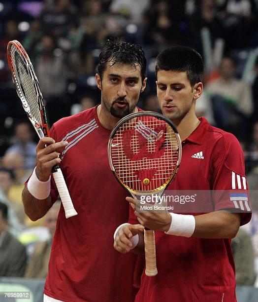 Nenead Zimonic and Novak Djokovic of Serbia during day two of the Davis Cup world group playoff tie between Serbia and Australia at Belgrade Arena...