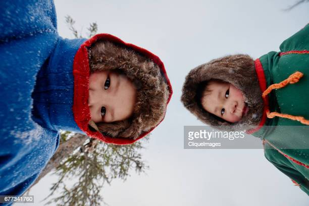 nenets children looking at camera - cliqueimages - fotografias e filmes do acervo