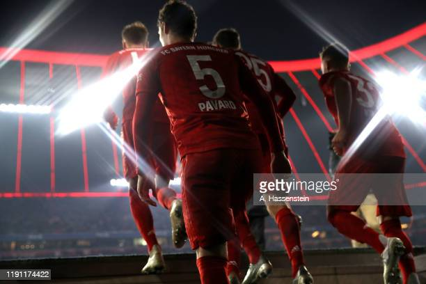 Nenjamin Pavard of FC Bayern Muenchen enter the field of play with his team mates at the players tunnel for the Bundesliga match between FC Bayern...