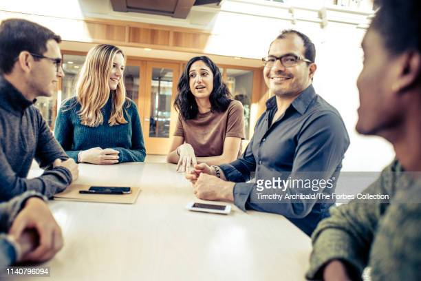 Neo founder Ali Partovi partner Nadia Singer are photographed with Neo scholars Joshua Meier and Christina Wadsworth for Forbes Magazine on October...