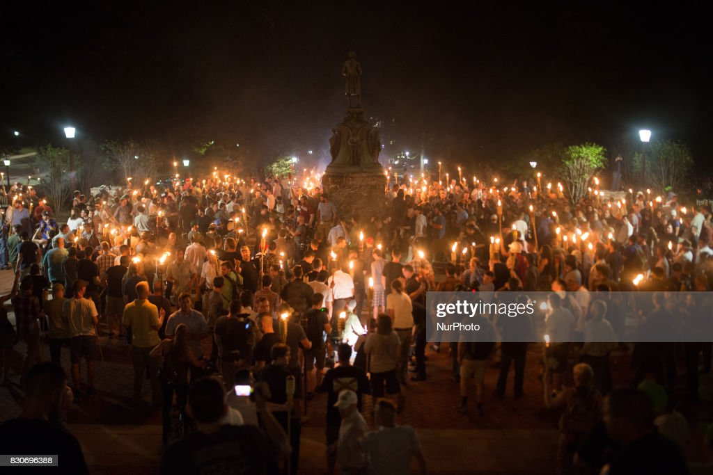 Neo Nazis, Alt-Right, and White Supremacists encircle counter protestors at the base of a statue of Thomas Jefferson after marching through the University of Virginia campus with torches in Charlottesville, Va., USA on August 11, 2017.