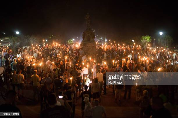 Neo Nazis, Alt-Right, and White Supremacists encircle counter protestors at the base of a statue of Thomas Jefferson after marching through the...