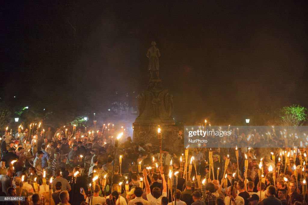 Neo Nazis, Alt-Right, and White Supremacists encircle counter protestors at the base of a statue of Thomas Jefferson after marching through the University of Virginia campus with torches in Charlottesville, Va., USA on August 11, 2017