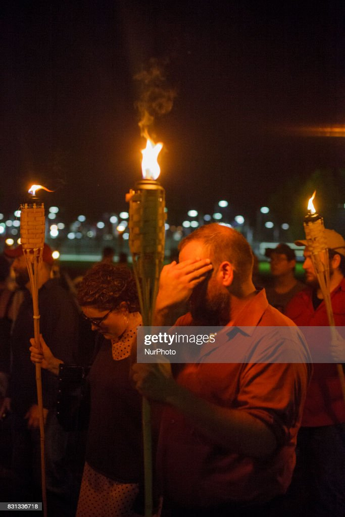 Neo Nazis, Alt-Right, and White Supremacists take part a the night before the 'Unite the Right' rally on 11 August 2017 in Charlottesville, VA, white supremacists march with tiki torchs through the University of Virginia campus.