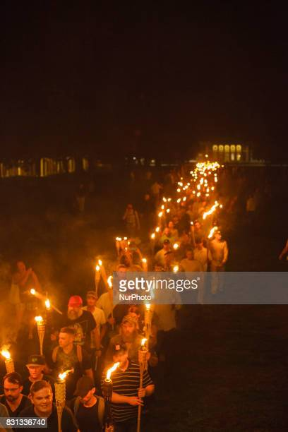 Neo Nazis AltRight and White Supremacists take part a the night before the 'Unite the Right' rally in Charlottesville VA white supremacists march...