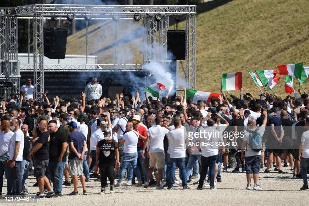Neo-fascist groups, extremists and ultras from Italy's football clubs gather for a demonstration over the government's handling of the coronavirus...