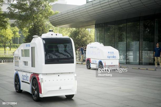 Neolix autonomous vehicles that use Baidu Inc Apollo technology sit on display during the Baidu Inc Create conference in Beijing China on Wednesday...