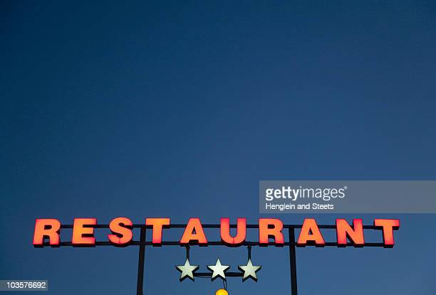 neon 3 star restaurant sign - rating stock photos and pictures