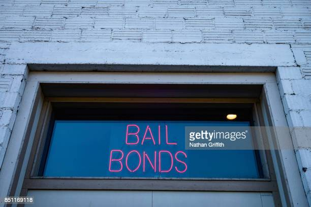 neon bail bond sign in window - bail law stock pictures, royalty-free photos & images