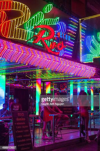 Neon bar signs & nightlife along Soi Cowboy street in 'Red Light District' of Bangkok, Thailand, named after Vietnam Vet who opened the first bar....