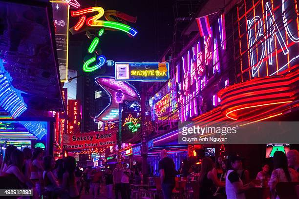 CONTENT] Neon bar signs nightlife along Soi Cowboy street in 'Red Light District' of Bangkok Thailand named after Vietnam Vet who opened the first...