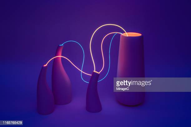 neon cable linking vases - creativity stock-fotos und bilder
